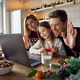 Happy family with kid daughter using laptop having virtual party on video call. - PhotoDune Item for Sale