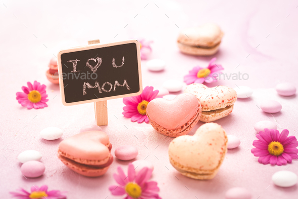 Happy Mothers Day - sweet macarons in heart shape with flowers - Stock Photo - Images
