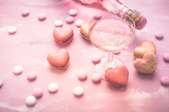 Happy Mothers Day - sweet macarons in heart shape and glass of rose sparkling wine - Stock Photo - Images