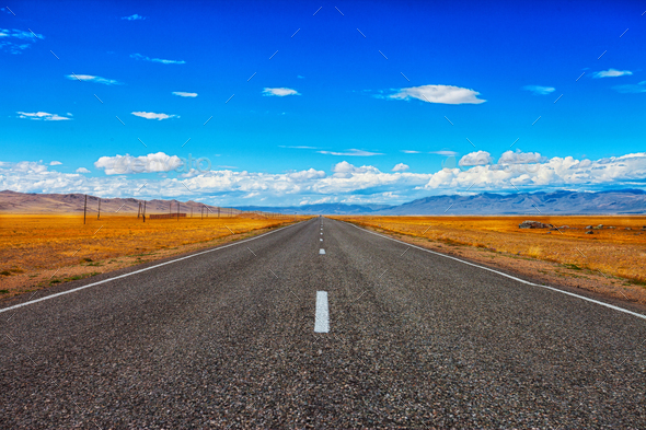 Road and blue cloudy sky - Stock Photo - Images