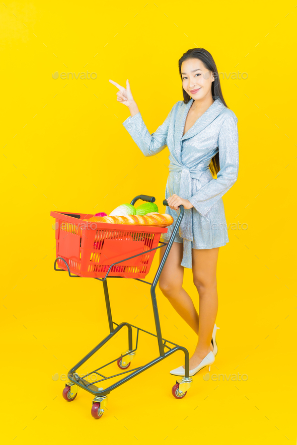 Portrait beautiful young asian woman smile with grocery basket - Stock Photo - Images