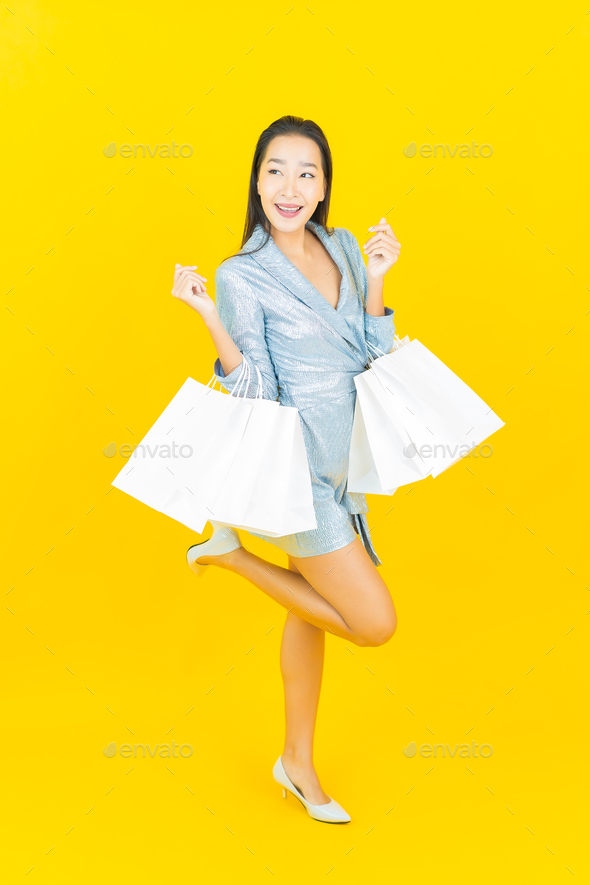 Portrait beautiful young asian woman smile with shopping bag - Stock Photo - Images