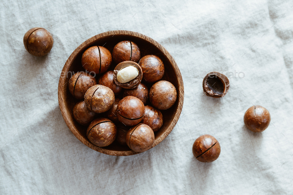 Top view of macadamia nuts on a wooden bowl - Stock Photo - Images