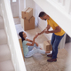 Couple Celebrating With Champagne Sitting On Floor Of New Home On Moving Day - PhotoDune Item for Sale