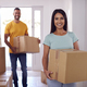 Portrait Of Couple Carrying Boxes Through Front Door Of New Home On Moving Day - PhotoDune Item for Sale