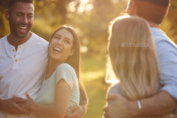 Group Of Friends On Walk In Countryside Against Flaring Sun - Stock Photo - Images