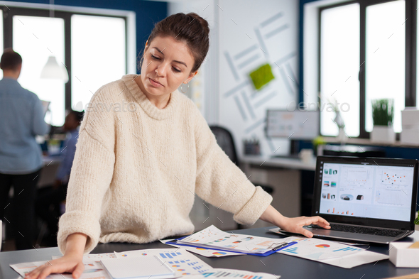 Financial charts analysed in start up company by business owner - Stock Photo - Images