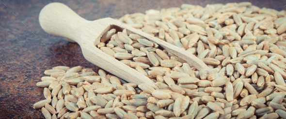 Rye grain on old rustic background. Agriculture concept - Stock Photo - Images