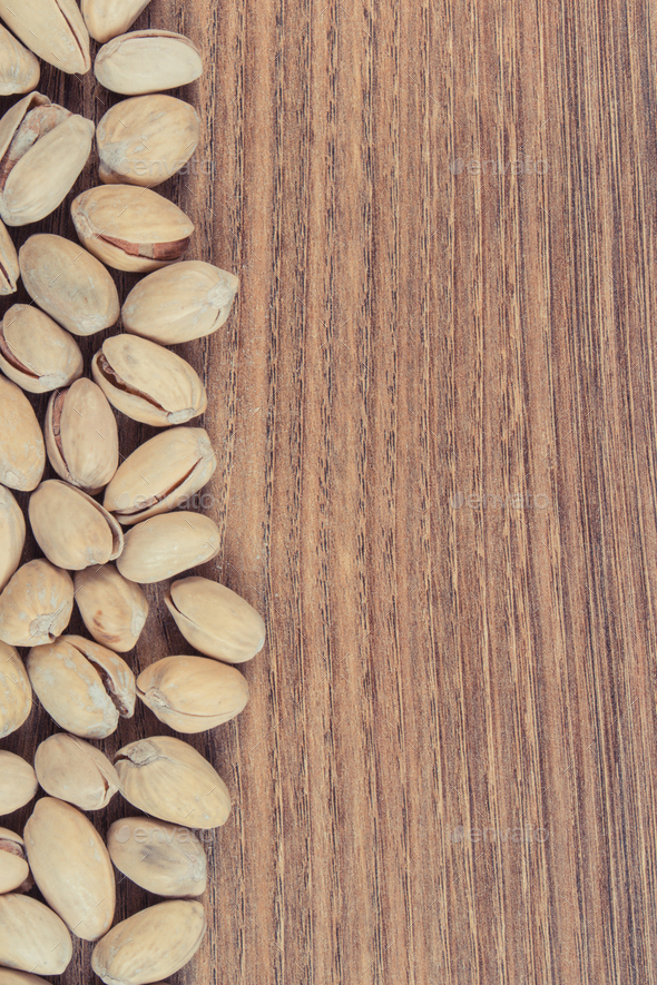 Pistachio nuts containing vitamins and minerals. Healthy eating. Place for text - Stock Photo - Images