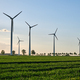 Wind turbines in a grain field with back light - PhotoDune Item for Sale