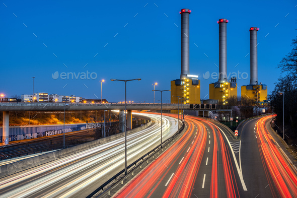 Highway and  power station at night - Stock Photo - Images