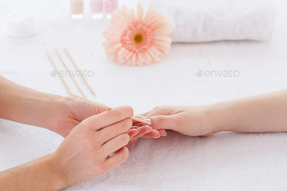 Nails cleaning. Close-up of beautician cleaning nails of female customer - Stock Photo - Images