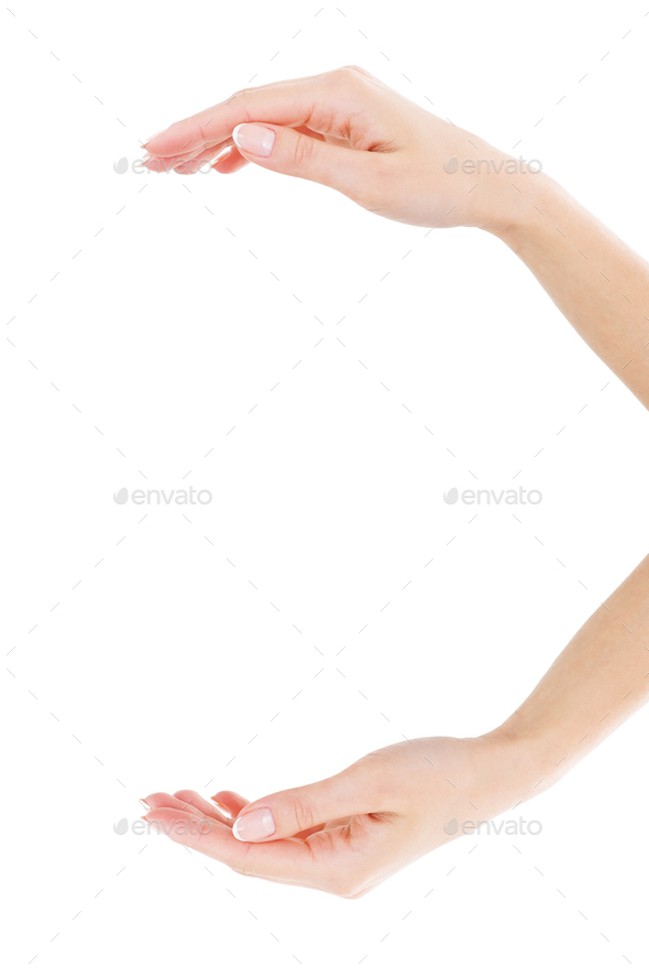 Holding copy space. Close-up of beautiful female hands holding copy space while isolated on white - Stock Photo - Images