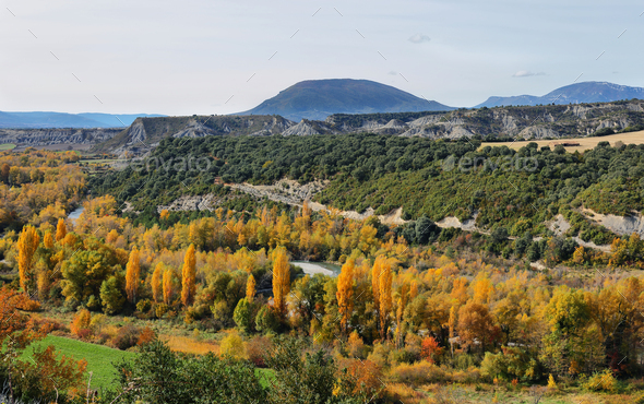 Rock formations and autumn forest from Binies village, Spain - Stock Photo - Images