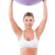 Woman with fitness ball. Attractive mature woman holding fitness ball and smiling at camera - PhotoDune Item for Sale