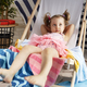 Relaxed little girl lying outdoor chair in swimwear - PhotoDune Item for Sale