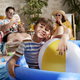 Portrait of relaxed boy in an inflatable ball pool at home - PhotoDune Item for Sale