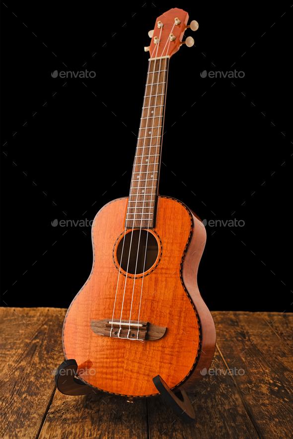 Ukulele Hawaiian guitar on wooden backgroun close up - Stock Photo - Images