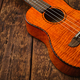 Ukulele Hawaiian guitar on wooden backgroun close up - PhotoDune Item for Sale