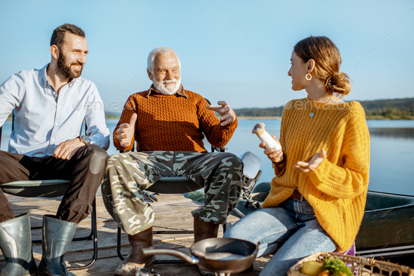 Grandfather with son and daughter on the picnic - Stock Photo - Images