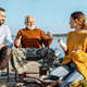 Grandfather with son and daughter on the picnic - PhotoDune Item for Sale