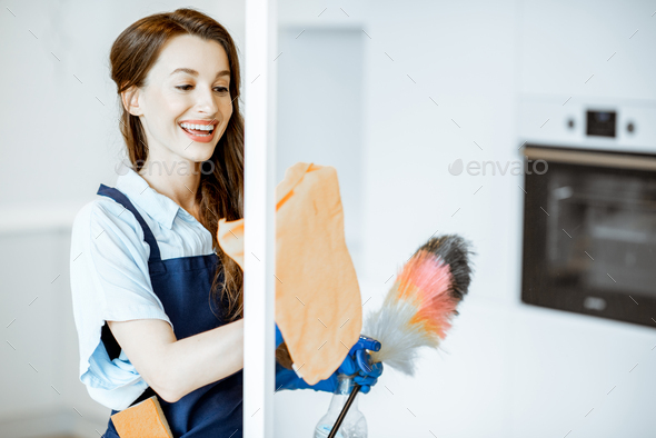 Woman cleaning at home - Stock Photo - Images
