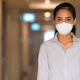 Asian woman wearing face mask to protect from coronavirus Covid-19 at apartment hallway - PhotoDune Item for Sale