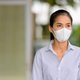 Asian woman wearing face mask to protect from coronavirus Covid-19 while thinking - PhotoDune Item for Sale