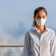 Asian woman wearing face mask to protect from coronavirus Covid-19 at rooftop outdoors while - PhotoDune Item for Sale