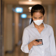 Asian woman wearing face mask to protect from coronavirus Covid-19 at apartment hallway while using - PhotoDune Item for Sale