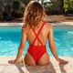 Young woman in red swimsuit relax near a swimming pool - PhotoDune Item for Sale