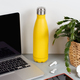 Yellow insulated bottle on grey desk surrounded by modern gadgets and plant - PhotoDune Item for Sale