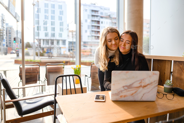 Close Friends Greeting At Cafe During Schoolwork - Stock Photo - Images