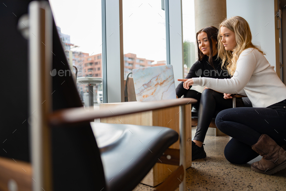 Two Women Working Together With Project On Laptop At Cafe - Stock Photo - Images