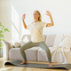Focused retired mature woman in sportswear practicing yoga asana at home while standing on mat - PhotoDune Item for Sale