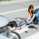 Road accident with injured cyclist and man providing first aid - PhotoDune Item for Sale