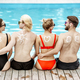 Friends with sun cream on the swimming pool outdoors - PhotoDune Item for Sale