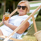 Senior woman on the sunbed outdoors - PhotoDune Item for Sale