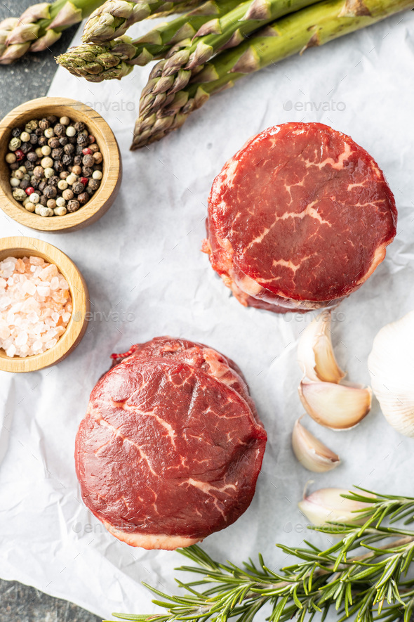 The raw beef meat steak on white papper. - Stock Photo - Images