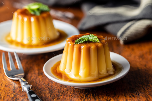 Sweet vanilla pudding. Sweet dessert with caramel topping. - Stock Photo - Images