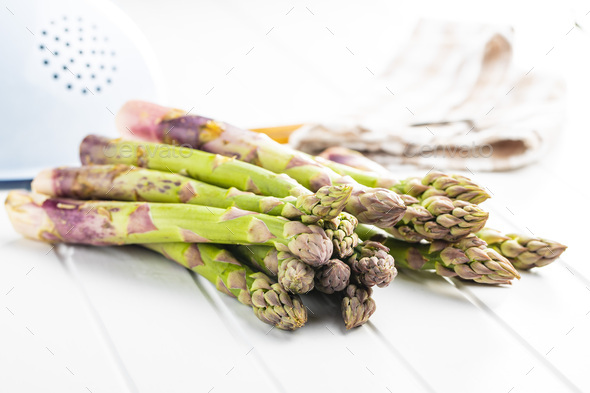 Fresh raw uncooked green asparagus. - Stock Photo - Images