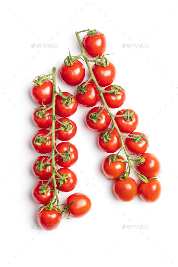 Fresh red cherry tomatoes. Small tomatoes on branch. - Stock Photo - Images