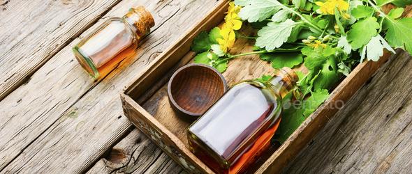 Medicinal tincture of celandine,herbal medicine. - Stock Photo - Images
