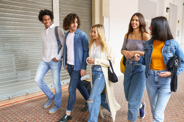 Multi-ethnic group of friends walking together on the street - Stock Photo - Images