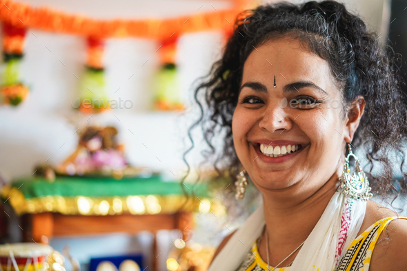Portrait of happy southern asian woman wearing sari dress - Focus on face - Stock Photo - Images