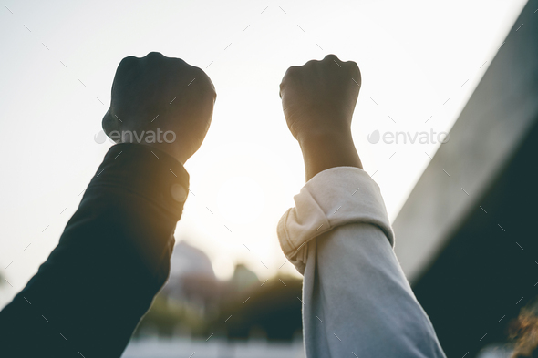 Black people holding hands during protest for no racism - Stock Photo - Images
