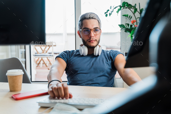 Young business man working inside modern office during coronavirus outbreak - Focus on face - Stock Photo - Images