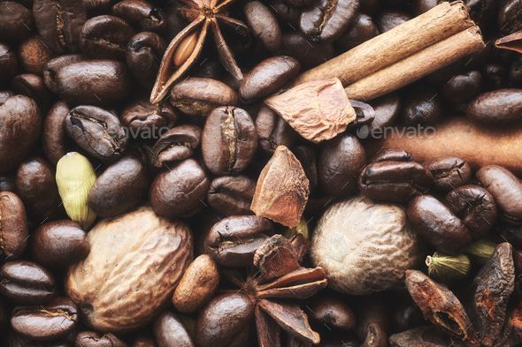 Dark coffee beans, anise, cinnamon stick, cardamom pods and nutmegs. - Stock Photo - Images
