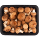 brown champignons mushrooms in black packaging on white - PhotoDune Item for Sale