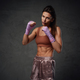 Female fighter staying in fighting stance in dark background - PhotoDune Item for Sale